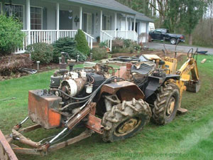 Cast tractor with dozer and backhoe